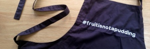 Be a coeliactivist in the kitchen with your very own embroidered 'fruit is not a pudding' apron!
